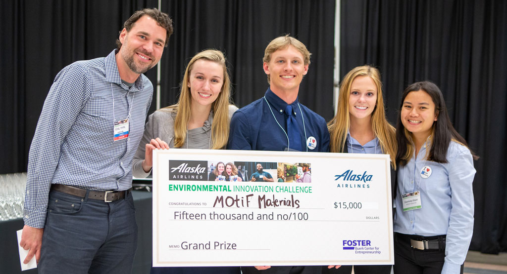 Student team behind MOtif Materials with giant check