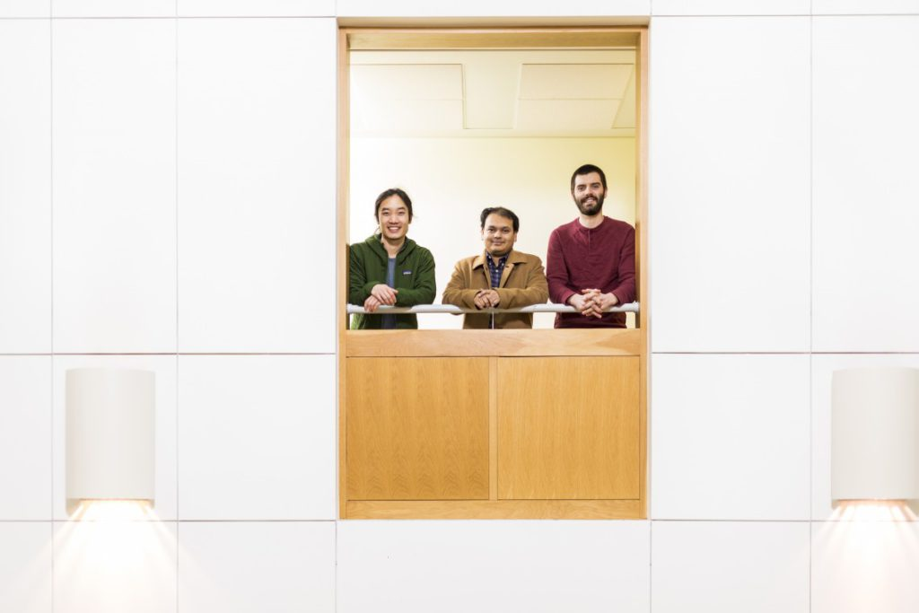 Arka Majumdar (center) and graduate students Alan Zhan (left) and Shane Colburn (right)